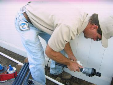 Apache junction sprinkler repair technician replaces backflow